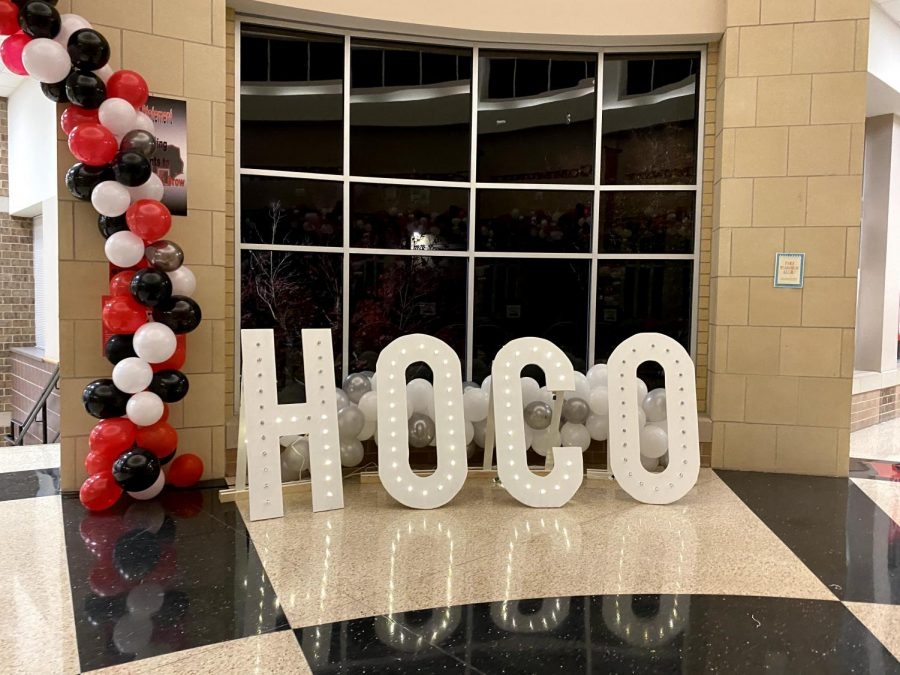 Though the Homecoming dance this year is unable to happen due to precautions, StuCo decorates the school in hopes that spirit week can continue.