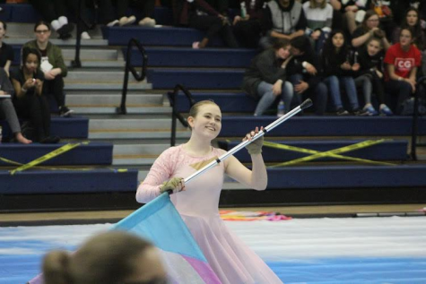 Given the option of learning a new instrument or joining colorguard, sophomore Elizabeth Allphin decided to follow in her older sister