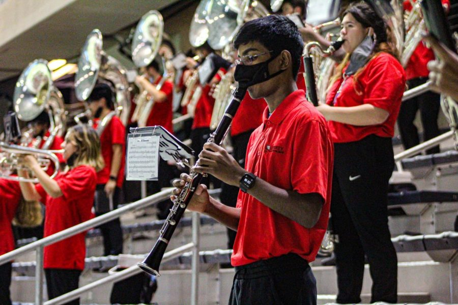 """A group of band members are preparing for their final audition period which ends Wednesday at midnight. """"If a student advances passed area, then they will be a member of one of the All-State Ensembles, meaning the student is one of the top performing students in the entire state,"""" associate band director Cecily Yoakam said."""