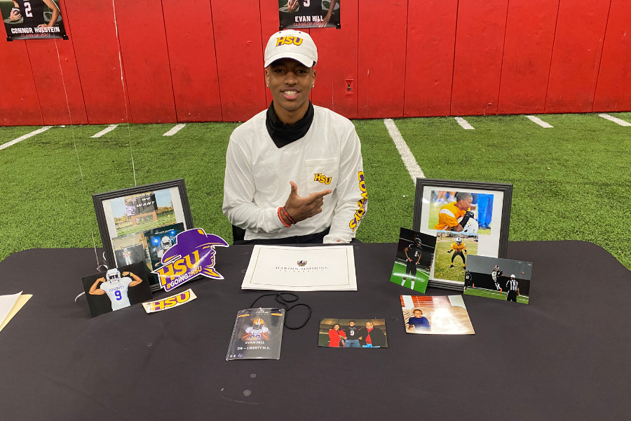 Continuing his athletic career at Hardin Simmons University, Evan  Hill signed his letter of intent Wednesday morning in the field house.