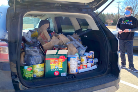 "After cars were filled with cans and boxes of food, they were taken to Frisco Family Services. ""We're just trying to do our part, we're bringing canned foods, waters, and other items so we can help those in need,"" junior Brady McNally said."