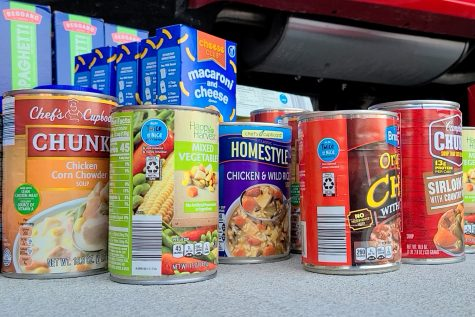 Canned food and other non-perishable food items are among the items journalism adviser Brian Higgins and his 12-year-old son Owen bought on Saturday for Monday
