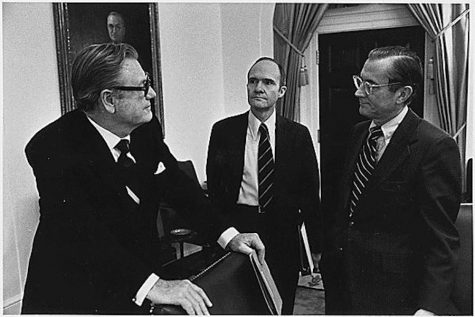 Former CIA Director William Colby (right) talks with former Deputy Assistant for National Security Affairs Brent Scowcrof (middle) and former Vice President Nelson A. Rockefeller (left) about the Vietnam War during a break from a meeting of the National Security Council on April 24, 1975.