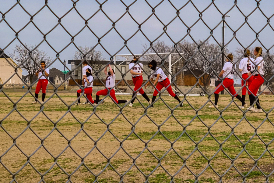 Stretching before a game, the Redhawks softball has started off slow with the team looking for its first win Friday at Lone Star.