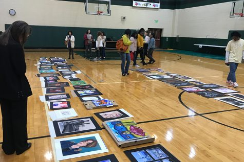 In the past years, students competing in VASE would travel to the selected high school and be interviewed about their piece and then scored 1-4, with the top scores of 4 then placed on the floors of the gym. VASE 2021 is a bit different, as there are no interviews and the competition is completely  virtual, with art work being submitted online.