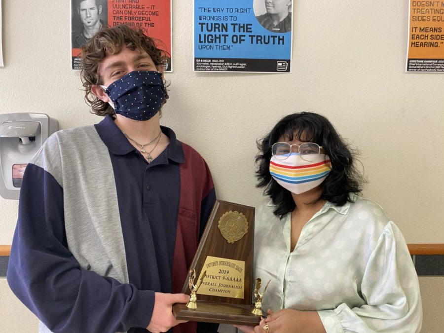 Wingspan Editor-in-Chiefs Aaron Boehmer and Trisha Dasgupta pose with Wingspan's District 5A UIL Journalism trophy. Now, Wingspan has been named a Pacemaker finalist, one of the highest honors for high school publications in the country.
