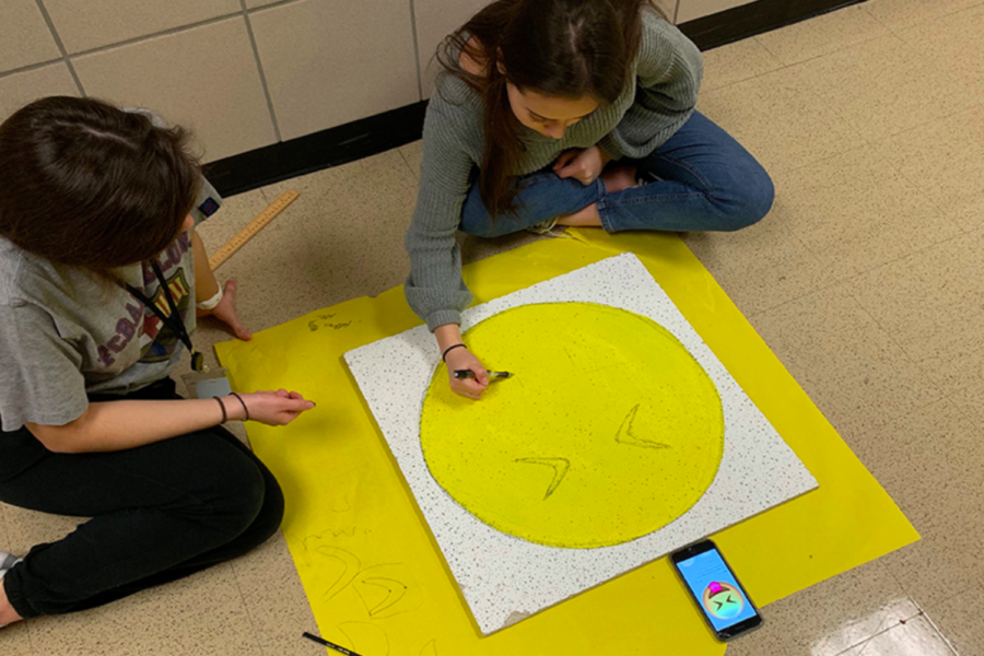 Continuing the annual ceiling tile project, pre-calculous students put their knowledge to the test as they painted their choice of art incorporating their final lesson in conics.