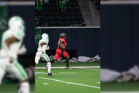 After scooping up a fumble, Redhawks quarterback (#12) Keldric Luster races into the end zone for a 62-yard touchdown run in the teams 41-24 win over Lake Dallas on Thursday at the Ford Center. Thursdays win moves the Redhawks to 5-0 overall, and 3-0 in District 7-5A.