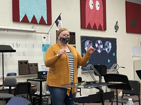 Originally thinking she might become a dentist, new assistant orchestra diredctor Madison Waggerman is now working alongside her former orchestra director.